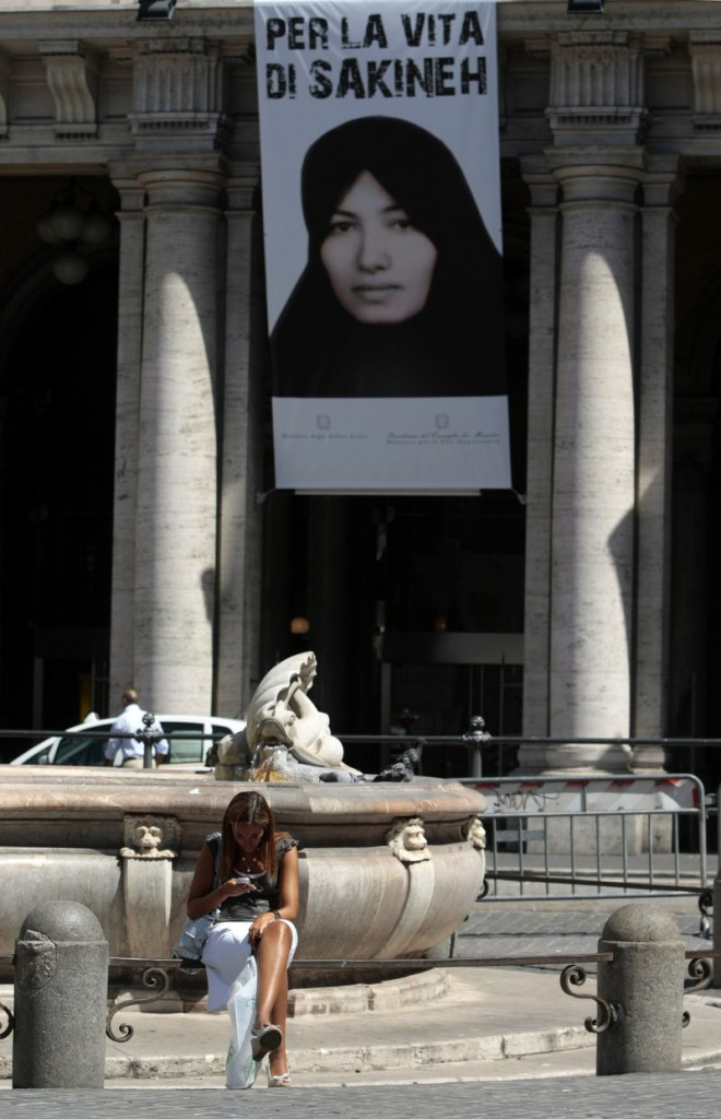 "A poster of Sakineh Mohammadi Ashtiani, the Iranian woman facing a sentence of death by stoning, hangs in central Rome from Italy's Equal Opportunities Ministry, which wants the sentence lifted. The writing reads in Italian: ""For the life of Sakineh."""