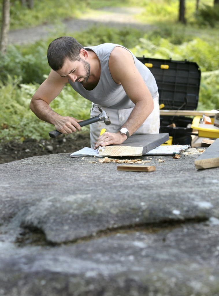 Wade Kavanaugh works on one of his picnic-table creations at Peaks-Kenny State Park.