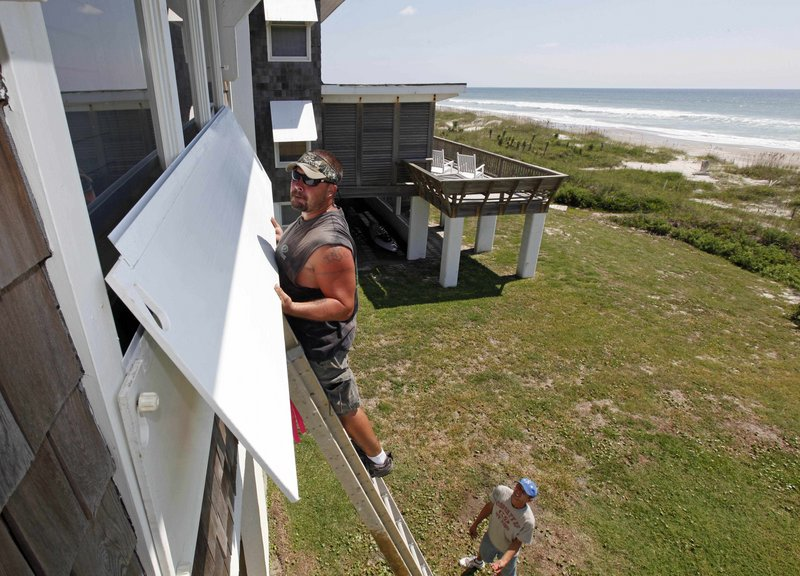 Scott Reese packs up his surfboards in Atlantic Beach, N.C., today as he prepares to evacuate.