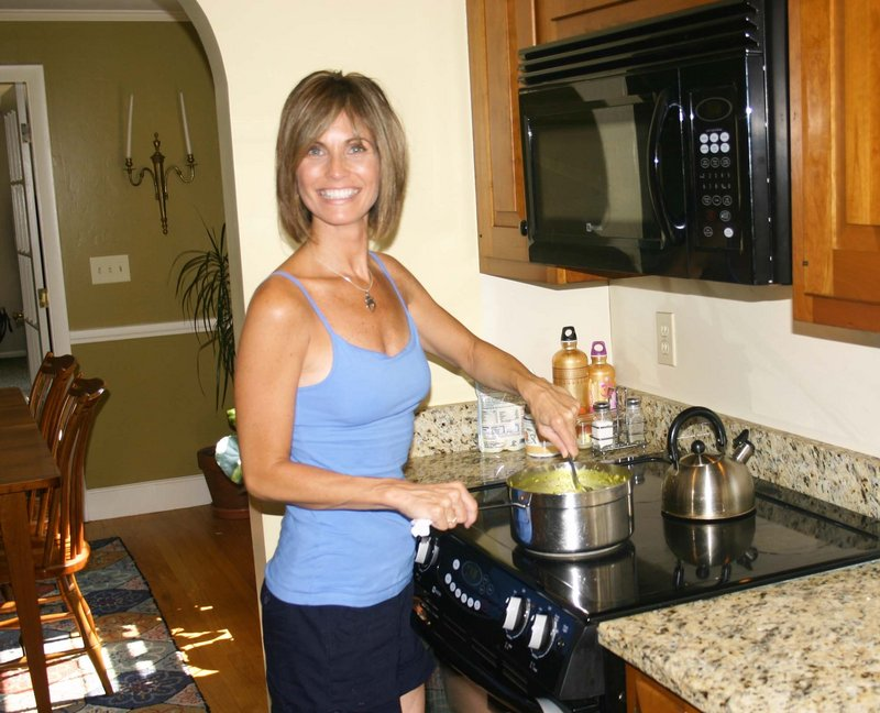 Certified ayurvedic consultant Sandra Maguire stirs a dish of kitcheri, made with mung dal, basmati rice, ghee, turmeric, cumin, coriander, ginger and mustard seed.