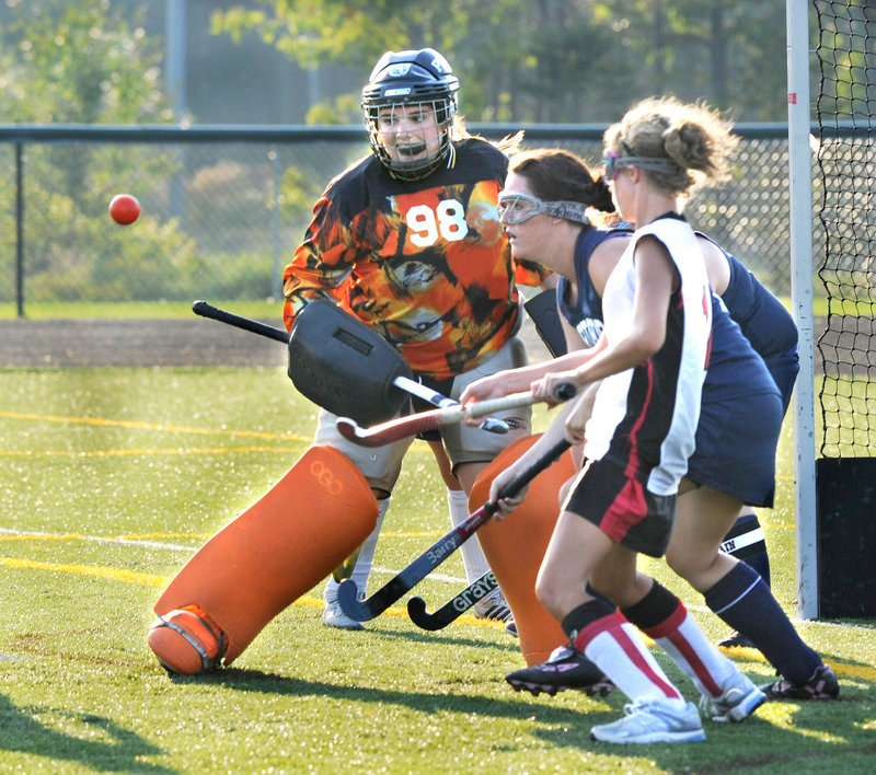 Portland goalie Kathleen Dalbec, who had 14 saves Thursday in the field hockey opener against Scarborough, deflects the ball away during a Red Storm surge. Scarborough opened its defense of the Class A state championship with a 5-1 victory.