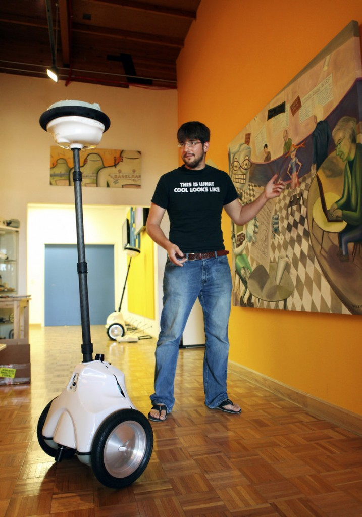 Robert Martinez, a mechanical engineer, demonstrates a QB robot at Anybots' offices in Mountain View, Calif.