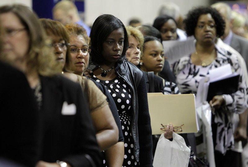 Lindsey Wright of Detroit, center, attends a recent job fair in Southfield, Mich. The number of people resuming their search for employment rose in August, overwhelming a slight increase in hiring by private companies.