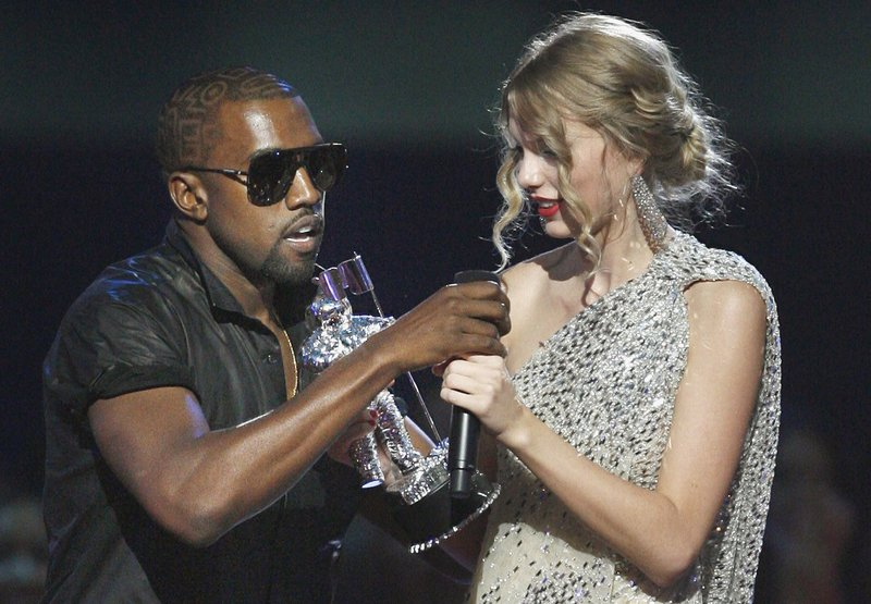 """Kanye West takes the microphone from Taylor Swift as she accepts the """"Best Female Video"""" award during the 2009 MTV Video Music Awards. West tweeted Saturday that he was wrong and his career had suffered."""