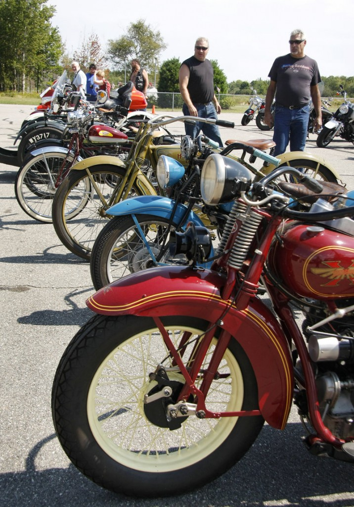 Visitors check out vintage motorcycles displayed at the Owls Head show Saturday.