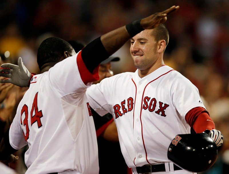 Ryan Kalish is about to be hugged by David Ortiz after hitting a grand slam in the fourth inning Monday night against Tampa Bay at Fenway Park. The Red Sox won, 12-5.