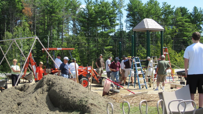 A large crew showed up despite 90-degree temperatures to install the Kelli Hutchison Memorial Playground at St. Ann's Episcopal Church in Windham.