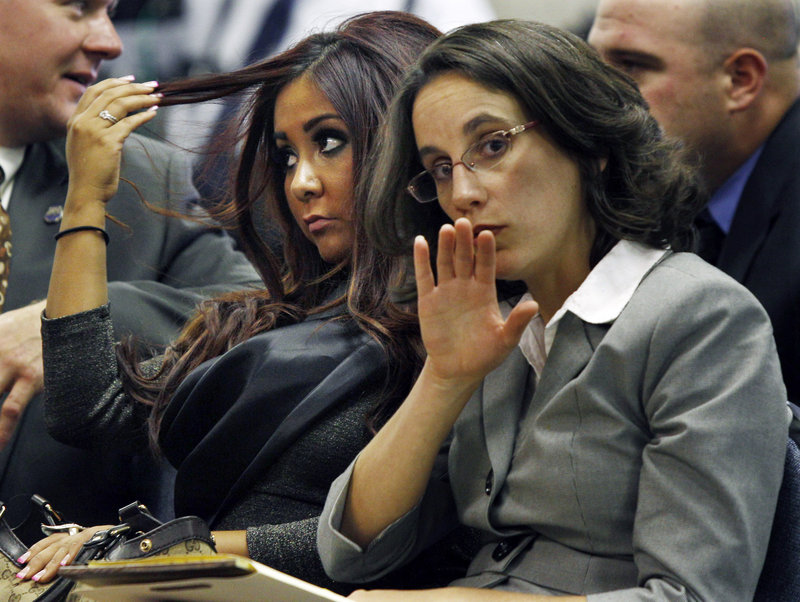 "Nicole Polizzi, left, better known as ""Snooki"" from the MTV show ""Jersey Shore,"" waits in court with a friend Wednesday in Seaside Heights, N.J."