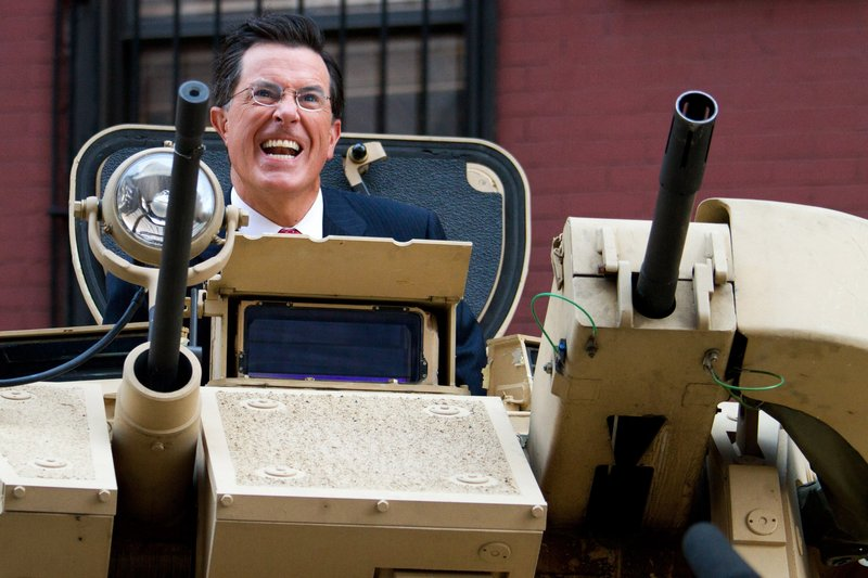 Stephen Colbert rides an Army tank in New York on Wednesday.
