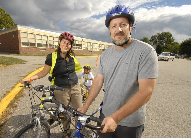 Bruce Hyman, Portland's bicycle-pedestrian coordinator, is shown with Sarah Cushman of the Safe Routes to School program and her daughter, Cedar Levin, 3.