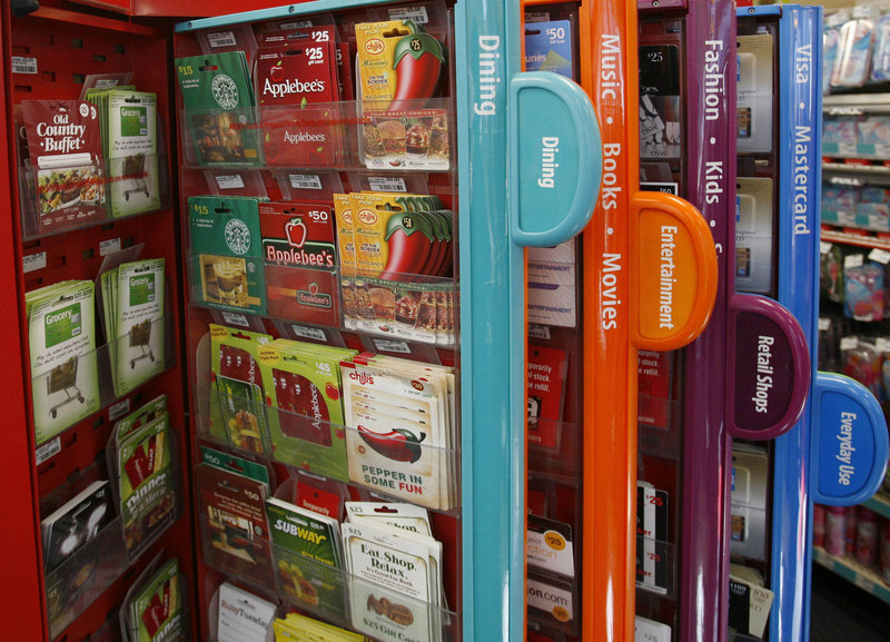 Gift cards are offered for sale from a kiosk in New York. New rules mean users have longer to use the cards and don't face as many costs up front.
