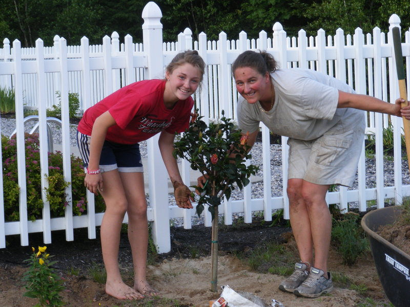 Laura Pate, right, is pictured with her niece Katlyn Barden gardening at Lisa Pate-Barden's house in Dayton.
