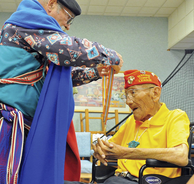 Larry Kimmel, with the Military Order of the Purple Heart, awards the Warriors Medal of Valor to Sgt. Allen D. June, one of the 29 original Navajo Code Talkers, at the Bob Stump VA Medical Center in Prescott, Ariz., on July 29.