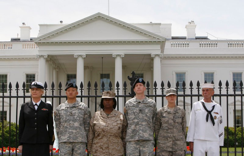 """From left, Petty Officer Autumn Sandeen, Lt. Dan Choi, Cpl. Evelyn Thomas, Capt. Jim Pietrangelo II, Cadet Mara Boyd and Petty Officer Larry Whitt handcuffed themselves to the fence outside the White House during an April 16 protest for gay rights. Activists are pressing Congress to repeal the military's """"don't ask, don't tell"""" policy."""