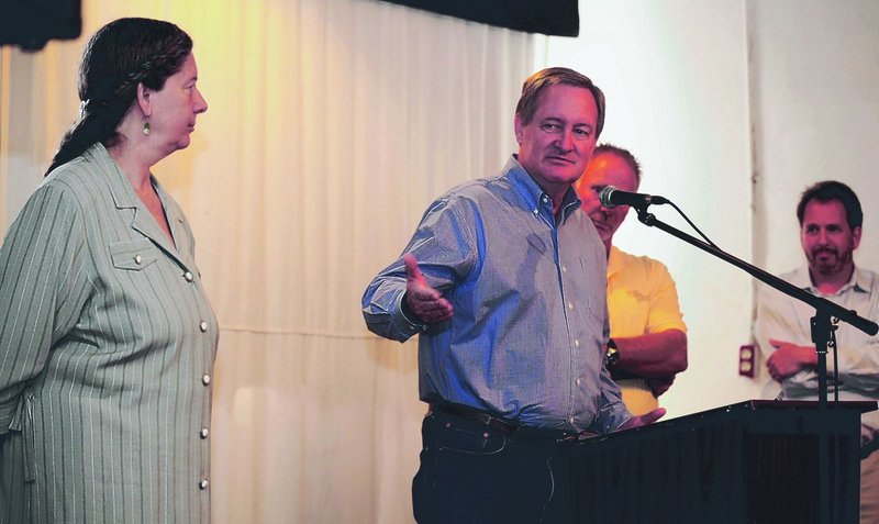 Sen. Mike Crapo speaks about a tax relief bill for small brewers at an August forum in Pocatello, Idaho. Crapo is flanked by Penny Pink, left, owner of Portneuf Valley Brewing; Scott Brown, president of the Idaho Grain Producers Association; and Dan Kopman, right, owner of a brewery in St. Louis, Mo.