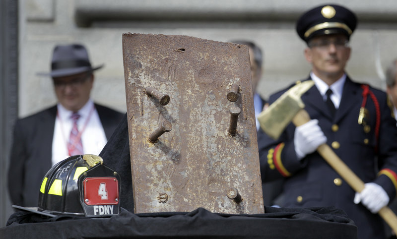 A piece of steel from the World Trade Center, and a firefighter's helmet signed by surviving members of New York City's Station 4 are seen at Cleveland's Patriot Day Ceremony on Friday. Cleveland this year focused attention on those who died in the attacks of Sept. 11, 2001.
