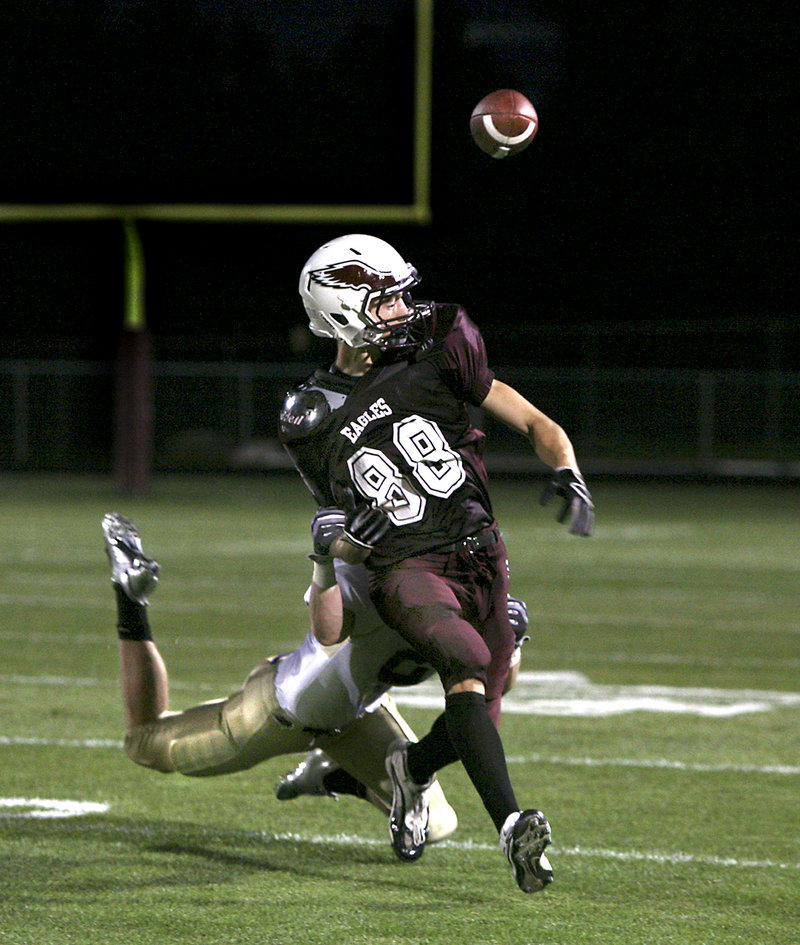 Drew Gagnon of Windham fumbles the ball out of bounds Friday night after making a reception. Liam Hobbins of Cheverus forced the fumble with his tackle. Cheverus moved to 2-0 with a 28-0 victory.