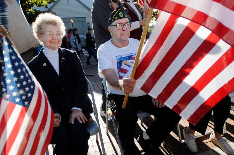 """Josephine and Roland Goss of Pownal joined the """"Flag Ladies"""" and about 200 others to pay tribute to 9/11 victims during a ceremony Saturday on Main Street in Freeport. Roland Goss is a veteran and commander of American Legion Post 83."""
