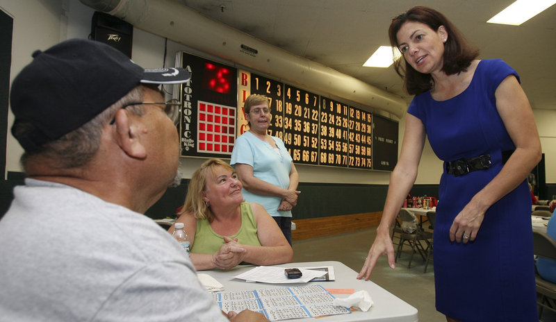 New Hampshire Republican Senate hopeful Kelly Ayotte greets bingo players in Manchester, N.H. Ayotte, a former attorney general, is campaigning as a conservative.