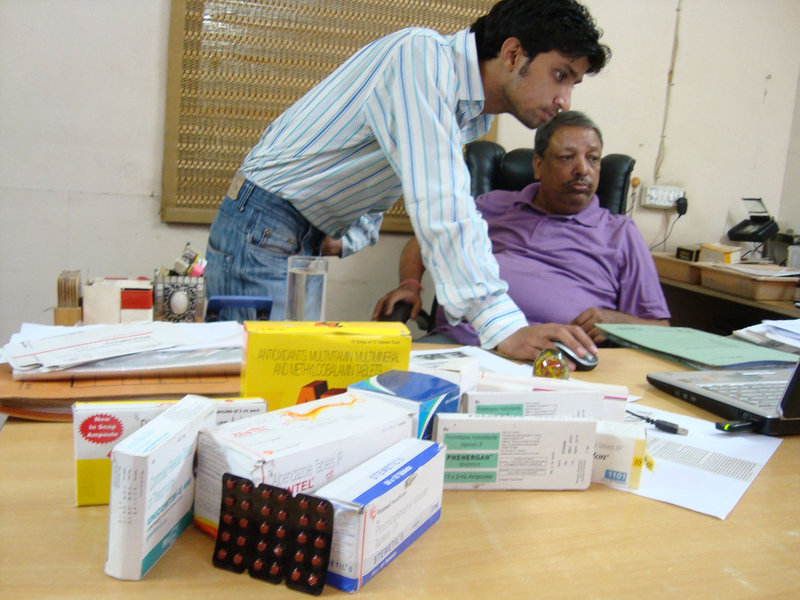 """When we bust one operation, two more spring up elsewhere,"" says investigator Suresh Sati, sitting, next to colleague Pankaj Dutt. India has become a center for making and selling fake and substandard medications."