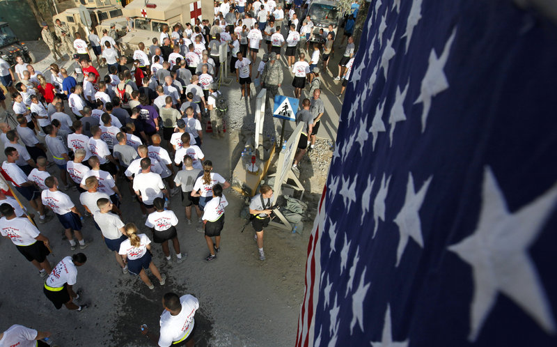 U.S. military personnel participate in the Patriot's Day 9.11 Kilometer Run, honoring those who lost their lives in the terrorist attacks of Sept. 11, 2001, at Bagram Air Field, north of Kabul, Afghanistan, on Saturday.