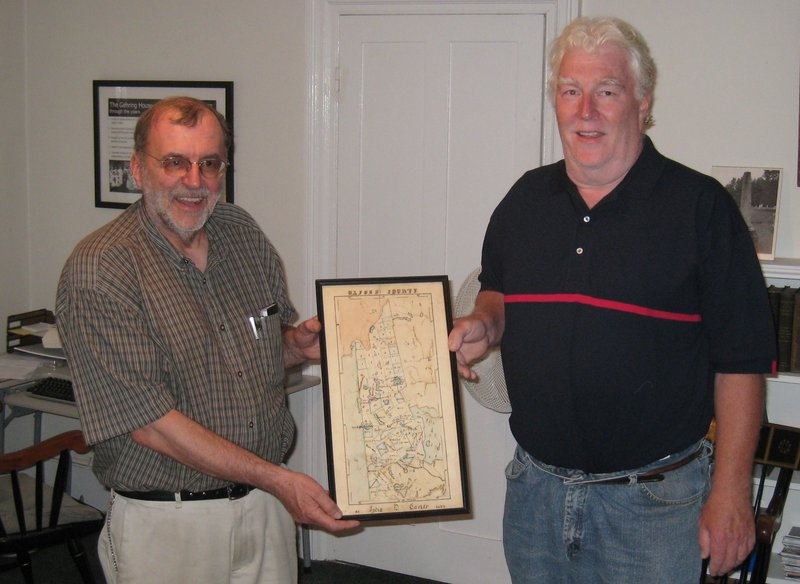 Stanley Howe, left, associate director of the Bethel Historical Society, and Joe Gaidis of Gaidis Antiques & Auctions hold a map of Oxford County created in 1835 by 12-year-old Bethel native Lydia Carter.