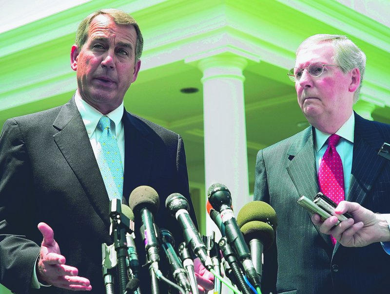 House Minority Leader John Boehner, left, and Senate Minority Leader Mitch McConnell face reporters in June. Boehner now says he would back renewing tax cuts for the middle class but not the wealthy if that was his only choice.