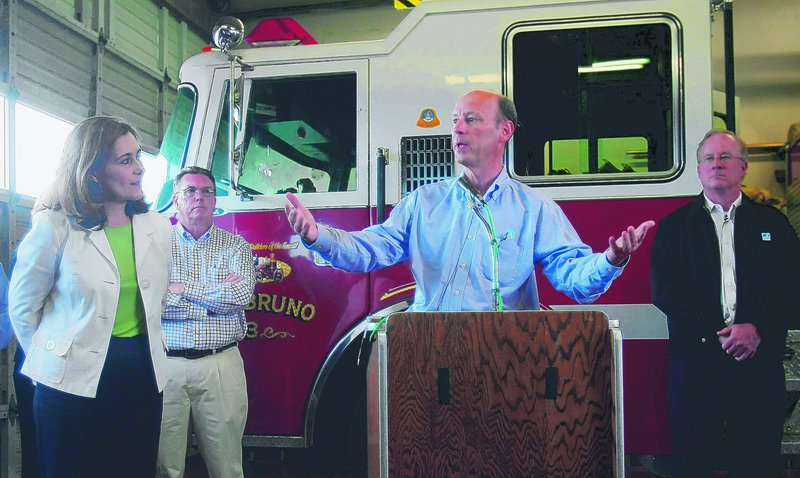Chris Johns, right, president of Pacific Gas & Electric Co., addresses reporters' questions in response to a gas pipeline explosion in San Bruno, Calif., on Monday. The utility said it has set aside up to $100 million to help residents recover.
