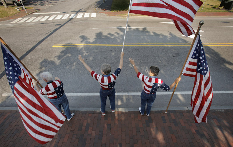 Freeport's Flag Ladies wave their banners on a recent Tuesday.
