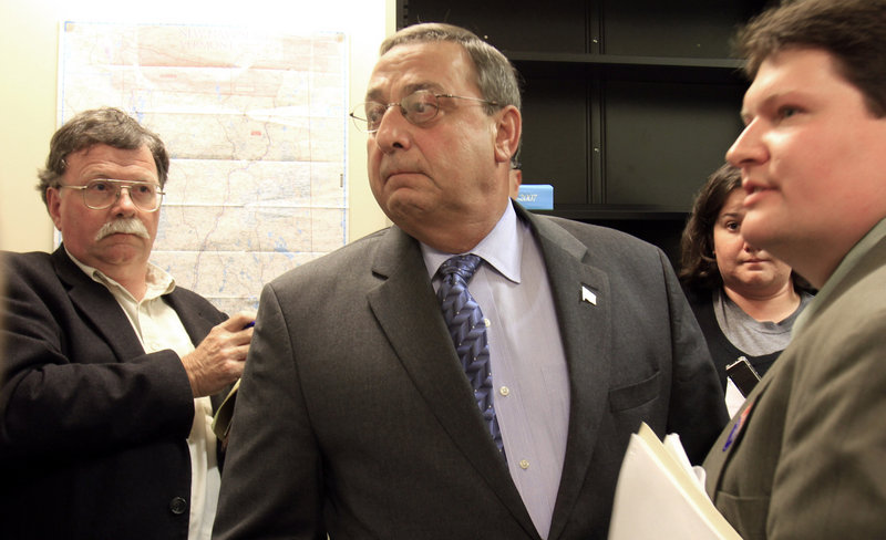 GOP gubernatorial candidate Paul LePage grows angry over media questions about property taxes on his wife's homes before abruptly ending a news conference Monday.