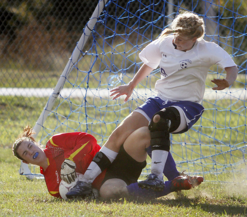 Sacopee Valley goalie Courtney Ross makes one of her 10 saves Tuesday while keeping the ball from Kelsey Koenigs of Old Orchard Beach during their Western Maine Conference schoolgirl soccer game. Sacopee Valley won, 1-0.