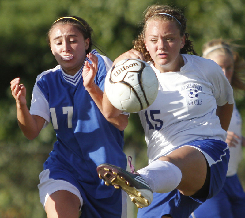 Taylor Blatchford of Old Orchard Beach clears the ball from danger as Emily Lane of Sacopee Valley moves in. Sacopee Valley improved to 3-0.