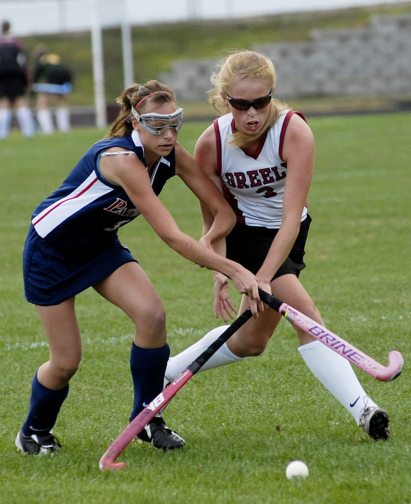 Jenna Labrecque of Gray-New Gloucester, left, and Jackie Andrews of Greely compete for the ball Wednesday during Greely's 3-0 victory in a Western Maine Conference field hockey game at Cumberland.