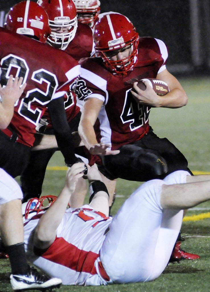 Matt Brown of Scarborough tries to find running room against Sanford. The Red Storm controlled the ball on the ground and ate up six minutes on their second scoring drive.