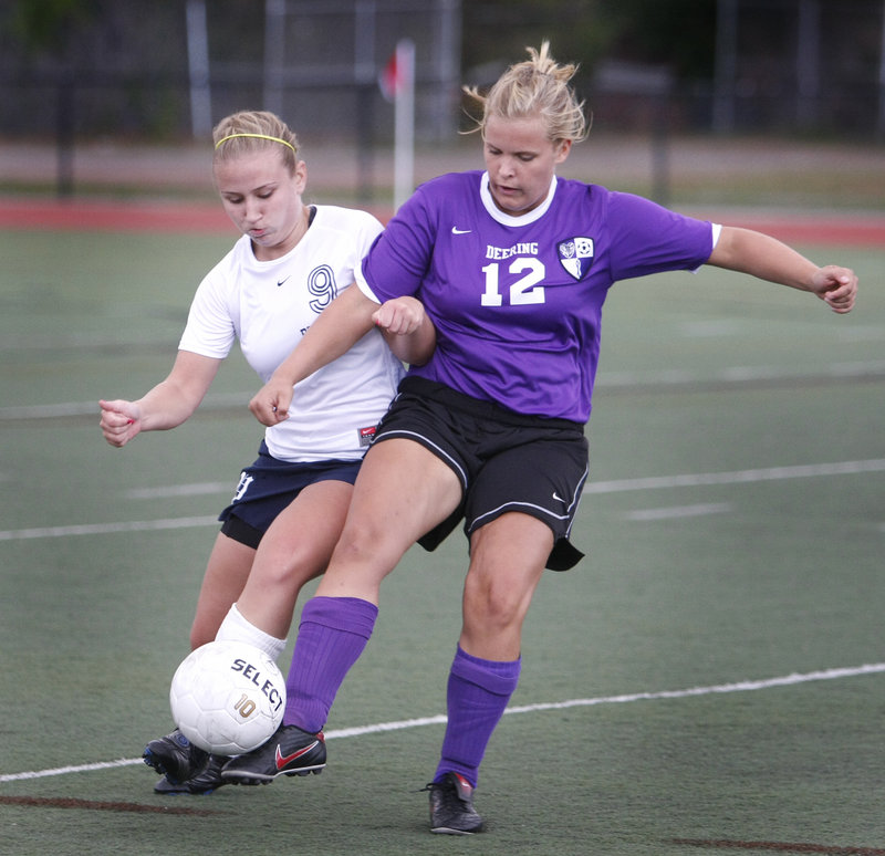 Casey Hart, left, of Portland and Deering's Lily Bourey maneuver for control of the ball during the Rams' 5-0 victory in an SMAA girls' soccer game Friday.