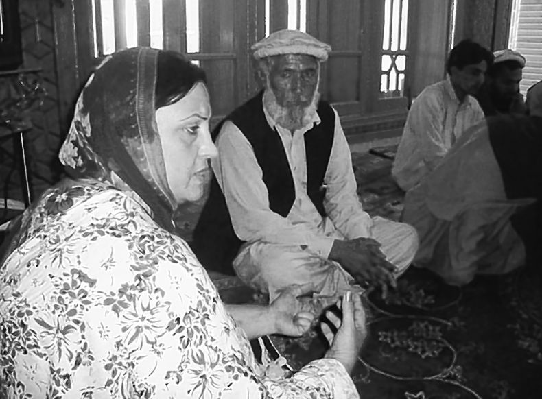 Hawa Nuristani meets with a delegation of supporters of her bid for re-election to her lower house of Parliament seat. She decided not to campaign in the province because of the threat of violence.