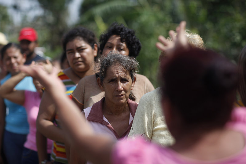People affected by Hurricane Karl wait in line for food in La Antigua, Veracruz state, Mexico, on Saturday.