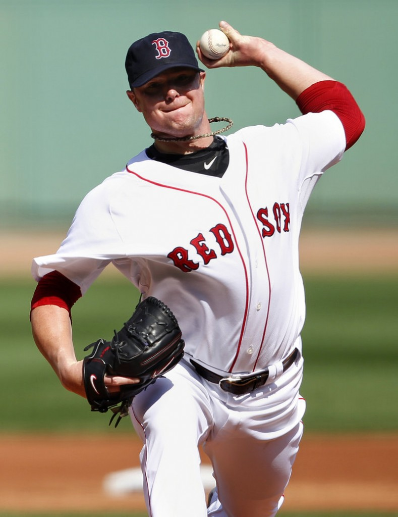 Jon Lester tosses a pitch during his seven innings of shutout ball Sunday against the Toronto Blue Jays. Boston won 6-0.