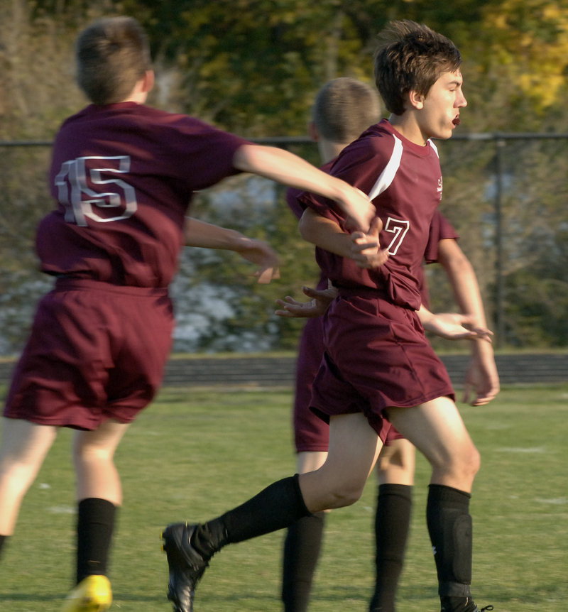 Sean Jackson, right, gets congratulations after scoring for Noble. Brian Vigneault had the other goal for the Knights.