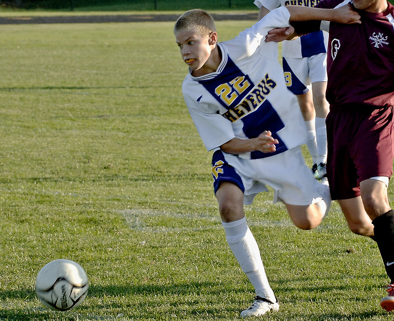 Sterling Weatherbie of Cheverus tries to keep the ball on the move Tuesday during an SMAA boys' soccer game against Thornton Academy. Cheverus won, 4-2.