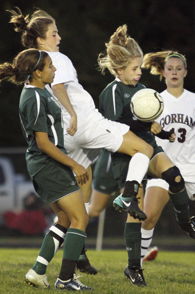 Kiersten Turner of Gorham attempts to control the ball Tuesday night while sandwiched by Allison Bonner, left, and Gabrielle Townsend of McAuley during Gorham's 2-0 victory at home.