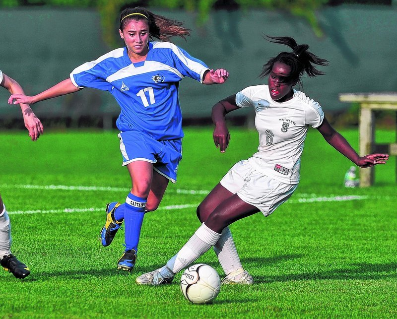 Emily Lane, left, of Sacopee Valley and Waynflete's Rhiannan Jackson race to the ball Wednesday at Portland. Lane had a goal and set up another in the Hawks' 2-1 victory.