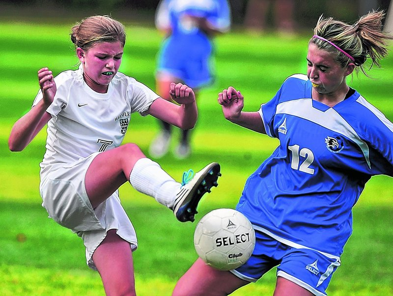 Walker Foehl, left, of Waynflete tries to kick the ball away from Amanda Cressy of Sacopee Valley during Sacopee's overtime win.