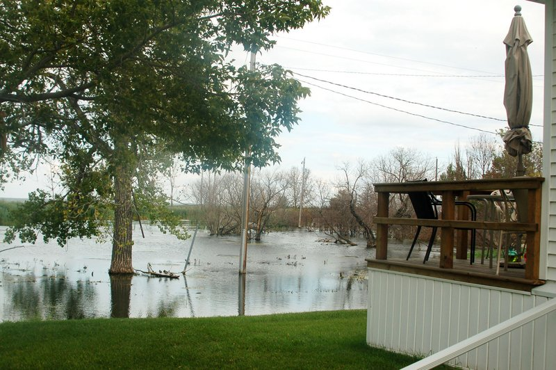 Devils Lake, which was once eight miles away from Minnewaukan, N.D., today is lapping at the community from three sides.