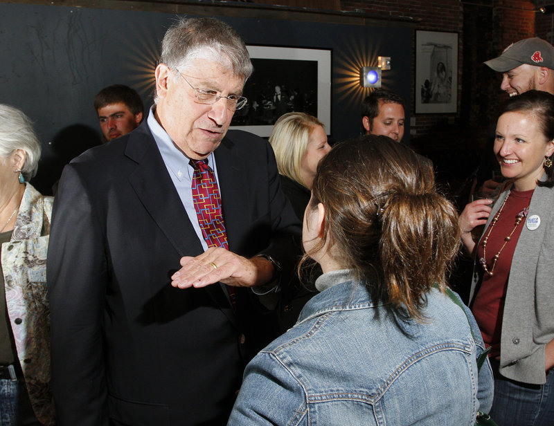 Eliot Cutler, independent candidate for governor, talks to Rori Crossman of Portland at a meet and greet at Empire Dine & Dance in Portland Thursday. Cutler s critics say he s out of touch, but backers say he's ready to take tough steps to address Maine issues.
