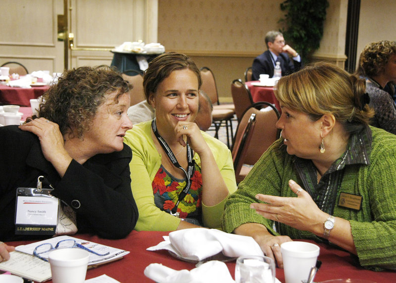 This is a two-line cutline Jill Brady/Staff Photographer:From left, Nancy Smith, Megan Rochelo, and Malory Shaughnessy visit during the Maine Development Foundation's 32nd Annual Meeting at the Holiday Inn By the Bay in Portland Friday, September 24, 2010.