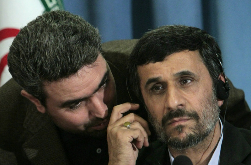Iranian President Mahmoud Ahmadinejad, right, confers with an aide during a news conference in New York on Friday that ranged from nuclear issues to the Sept. 11 attacks.