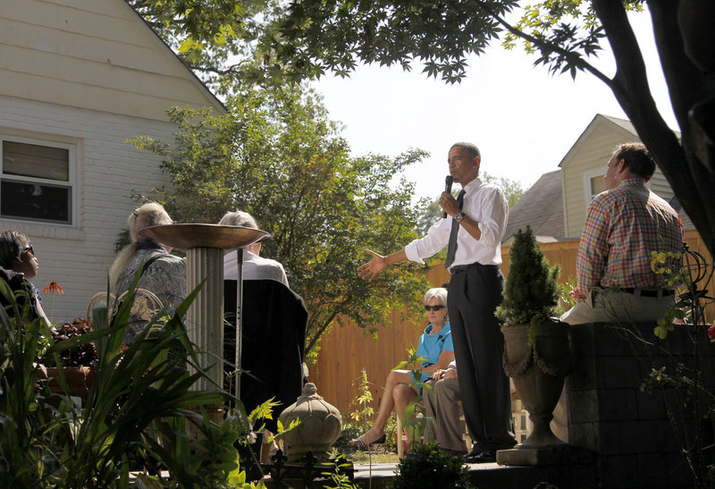 President Obama, accompanied by Health and Human Services Secretary Kathleen Sebelius, center, speaks at a private residence in Falls Church, Va., this month.
