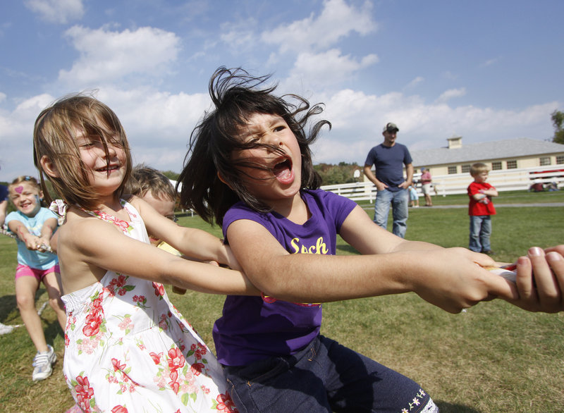Lucy Brogan, 5, left, of South Berwick and Momoka Mahara, 5, visiting from Japan, put all their might into the tug of war.
