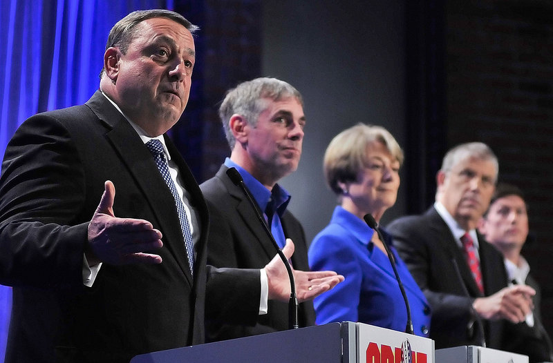 Republican Paul LePage, left, speaks as independent Shawn Moody, Democrat Libby Mitchell, independent Eliot Cutler and independent Kevin Scott listen Saturday night during the first of The Great Debates at the University of Maine at Augusta.